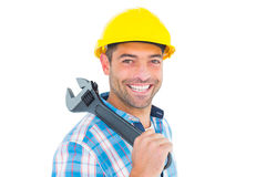 Smiling manual worker holding adjustable spanner Royalty Free Stock Photo