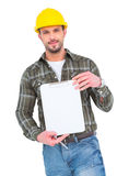 Smiling manual worker holding clipboard. On white background Royalty Free Stock Photography