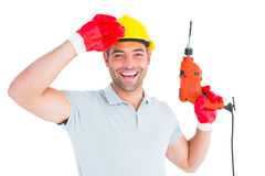 Smiling manual worker holding drill machine Stock Images
