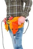 Smiling manual worker holding drill machine Stock Image