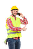 Smiling manual worker on the phone Royalty Free Stock Photography