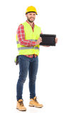 Smiling manual worker presenting shockproof digital tablet Royalty Free Stock Image