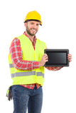 Smiling manual worker presenting shockproof digital tablet Royalty Free Stock Photography