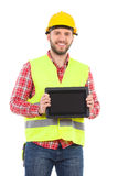 Smiling manual worker showing a shockproof digital tablet Royalty Free Stock Photography