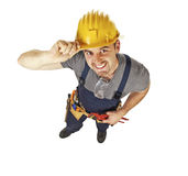Smiling manual worker on white Stock Images