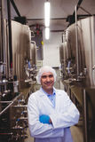 Smiling manufacturer standing at brewery Stock Photo