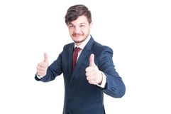 Smiling marketing manager showing thumbs up Royalty Free Stock Photography