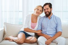 Smiling married couple. Portrait of smiling married couple sitting on the sofa Stock Photography