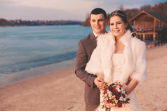 Smiling married couple on the river bank Royalty Free Stock Images