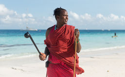 Smiling masai with sunglasses on a beach Royalty Free Stock Images