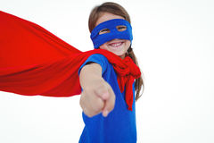 Smiling masked girl pretending to be superhero. Pointing at the camera on white screen Royalty Free Stock Photography