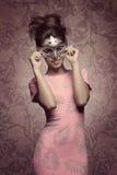 Smiling masquerade woman Stock Photo