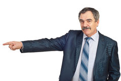 Smiling mature business man pointing Stock Photos