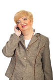 Smiling mature business woman on cellphone Stock Images
