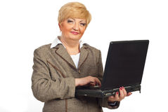 Smiling mature business woman with laptop Royalty Free Stock Photo