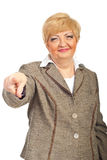 Smiling mature business woman pointing to you Stock Photo
