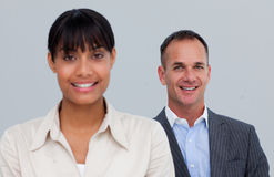 Smiling mature businessman behind his colleague Stock Photos