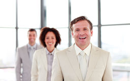 Smiling mature businessman leading a team Royalty Free Stock Photos