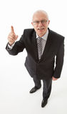 Smiling mature businessman looking and indicating up Royalty Free Stock Photo