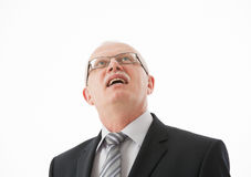 Smiling mature businessman looking  up Royalty Free Stock Photos