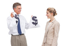 Smiling mature businessman showing money bags to his coworker Stock Photos