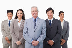 Smiling mature businessman standing with his team Stock Photos