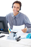 Smiling mature businessman working at his desk Stock Photos