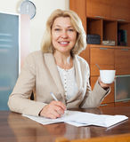 Smiling mature businesswoman with cup of tea Royalty Free Stock Image