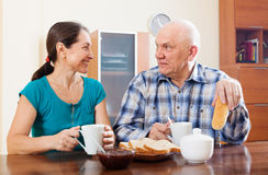 Smiling mature couple having breakfast Stock Photo