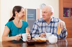 Smiling mature couple having breakfast Stock Photo