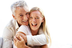 Smiling mature couple having a good time Stock Images