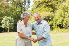 Smiling mature couple in park Stock Photo