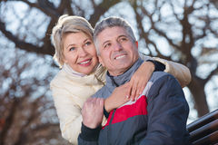 Smiling mature couple relaxing in park royalty free stock photography