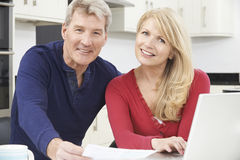 Smiling Mature Couple Reviewing Domestic Finances Stock Photo