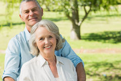 Smiling mature couple at summer park Stock Photo