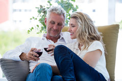 Smiling mature couple toasting red wine at home Royalty Free Stock Image