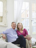 Smiling Mature Couple In White Home Interior Royalty Free Stock Photos