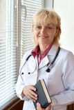 Smiling mature doctor Stock Photo