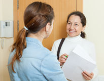 Smiling mature employee polling among people Stock Images