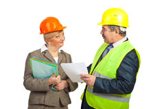 Smiling mature engineers having conversation Stock Photography