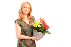 A smiling mature female holding flowers Stock Photos