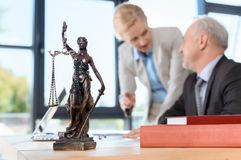 Lawyers discussing plans. Smiling mature lawyers discussing plans at workplace Stock Photos