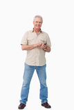 Smiling mature male with his cellphone Royalty Free Stock Photography