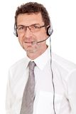 Smiling mature male operator businessman with headset call senter. Helpdesk Royalty Free Stock Photo