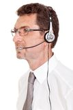 Smiling mature male operator businessman with headset call senter. Helpdesk Stock Photography