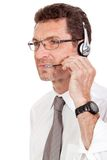 Smiling mature male operator businessman with headset call senter. Helpdesk Royalty Free Stock Image