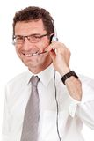 Smiling mature male operator businessman with headset call senter. Helpdesk Royalty Free Stock Photography