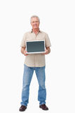 Smiling mature male presenting his laptop screen Stock Image