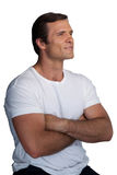 Smiling mature man with arms crossed Stock Image