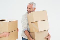Smiling mature man carrying boxes Royalty Free Stock Images